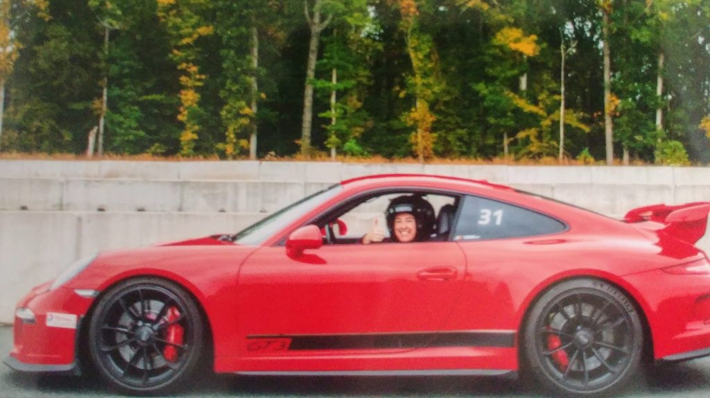 Author in a Porsche on a racetrack