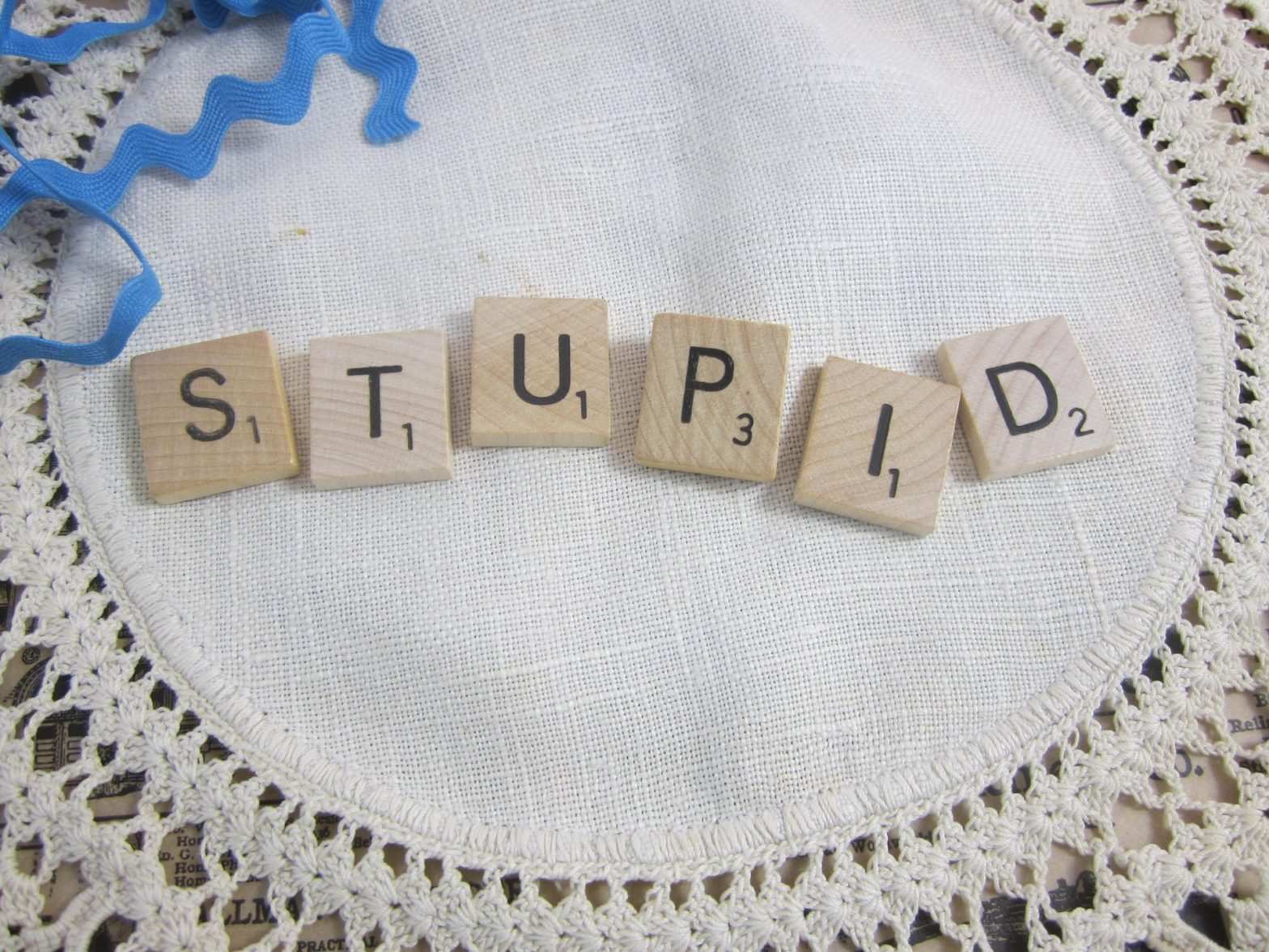 "Scrabble tiles that spell ""STUPID"""